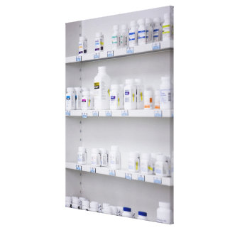 bottles on the shelves at a pharmacy canvas print