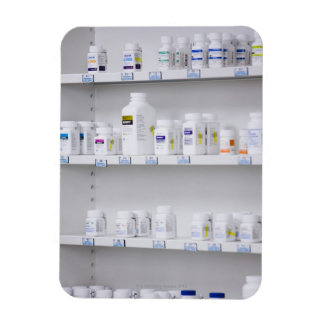 bottles on the shelves at a pharmacy magnet