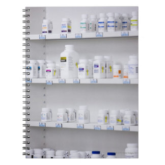 bottles on the shelves at a pharmacy notebook