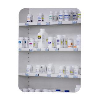 bottles on the shelves at a pharmacy rectangular photo magnet