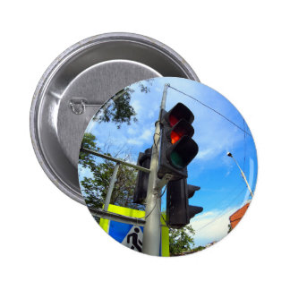 Bottom view on traffic light and road sign closeup 2 inch round button