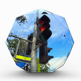 Bottom view on traffic light and road sign closeup awards