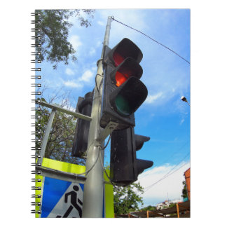 Bottom view on traffic light and road sign closeup notebook