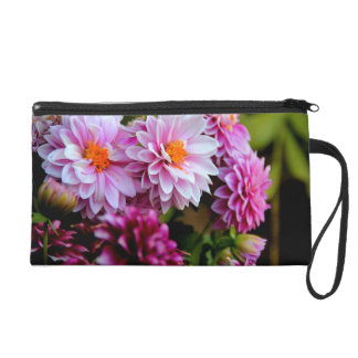 Bouquet of pink and purple flowers wristlet clutch