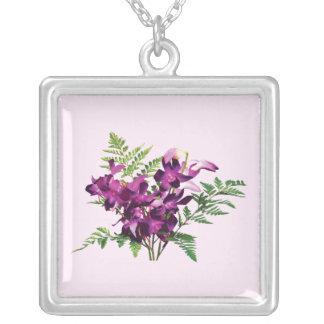 Bouquet of Purple Orchids With Ferns Pendants
