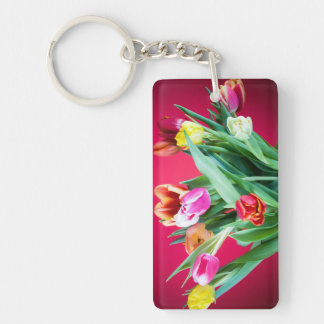 Bouquet of tulips on red keychain
