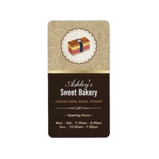 Boutique dulce de la panadería - pan que mira la etiquetas de dirección