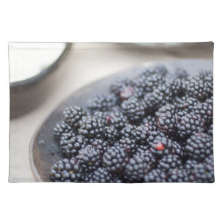 Bowl of blackberries on a table placemat