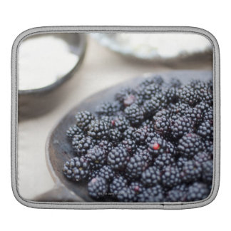 Bowl of blackberries on a table sleeve for iPads