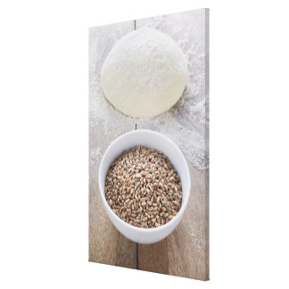 Bowl of Cereal Grain and Mound of Dough Canvas Print