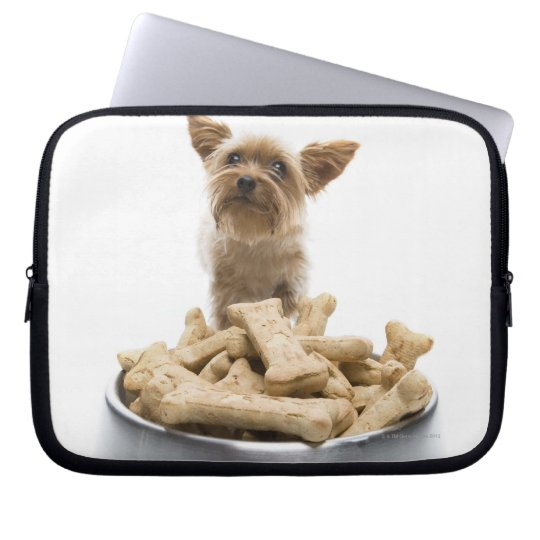 Bowl of dog treats by Yorkshire Terrier Laptop Sleeve