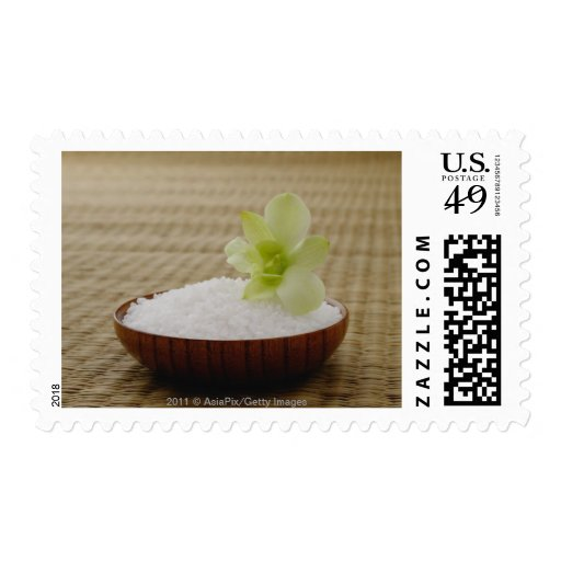 Bowl of rice with a flower on a tatami mat postage