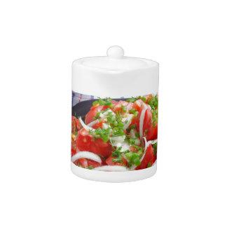 bowl of vegetarian salad teapot