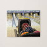 "Bowling Alley and bowling balls Jigsaw Puzzle<br><div class=""desc"">This wonderful image is perfect for those who love bowling.  Customize it as you with. Perfect for those tournament players or those who are weekend bowlers.</div>"