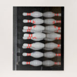 "Bowling Pin Jigsaw Puzzle<br><div class=""desc"">A jigsaw puzzle featuring a photo of a rack of bowling pins and their reflection. At check out, choose how large of puzzle you desire. If you believe the cost and shipping is too much to pay. Join Zazzle Black at check out to get unlimited free shipping, huge discounts and...</div>"