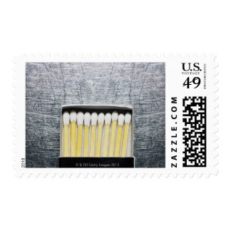 Box of wooden matches on stainless steel postage