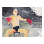 Boxeador entre la postal de los combates