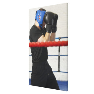 Boxer covering his face in ring stretched canvas print