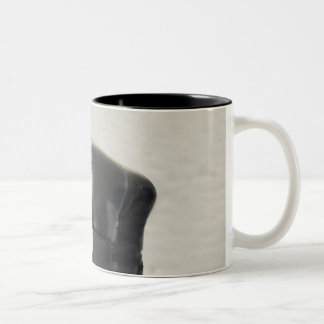 Boxer covering his face in ring Two-Tone coffee mug