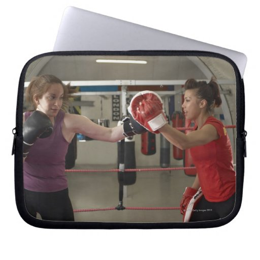 Boxer training with coach in gym computer sleeve