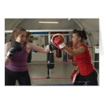 Boxer training with coach in gym greeting cards