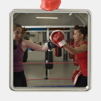 Boxer training with coach in gym metal ornament