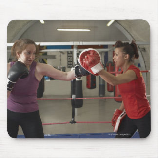 Boxer training with coach in gym mouse pad