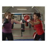 Boxer training with coach in gym poster