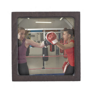 Boxer training with coach in gym premium gift boxes