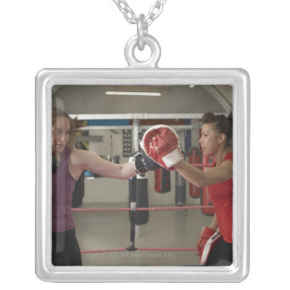 Boxer training with coach in gym silver plated necklace