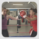 Boxer training with coach in gym square sticker