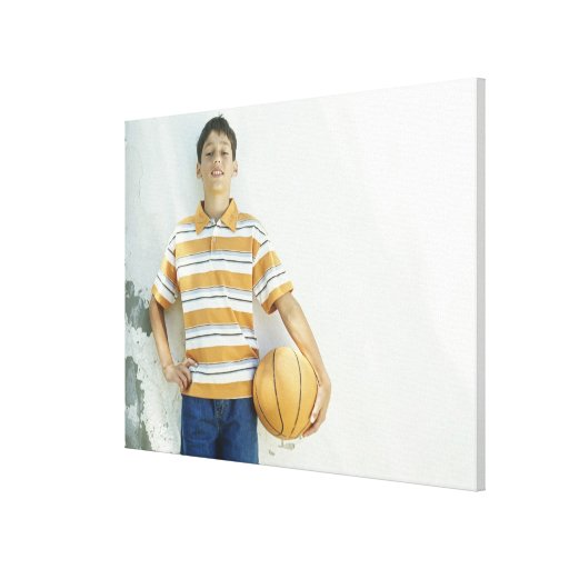 Boy (12-13) standing in front of white canvas print