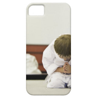 Boy (4-5 years) wearing karate outfit bowing, iPhone SE/5/5s case