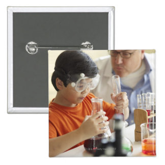 Boy (6-7) and teacher in chemistry class button