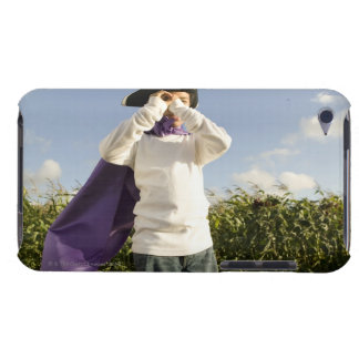 Boy (6-8) in cape and hat with imaginary iPod touch case