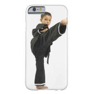 Boy (6-8) in karate outfit kicking barely there iPhone 6 case