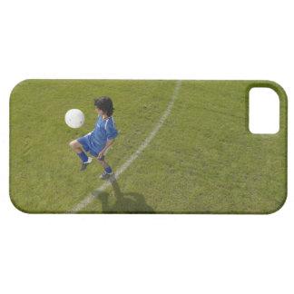 Boy (8-10) footballer practicing skills, iPhone 5 cases