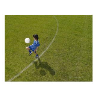 Boy (8-10) footballer practicing skills, postcard