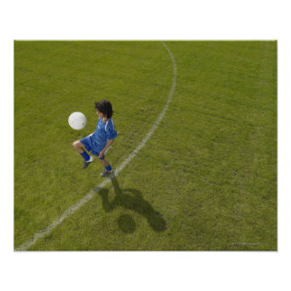 Boy (8-10) footballer practicing skills, poster