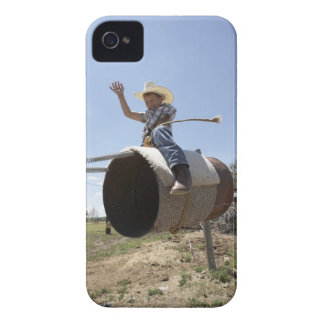 Boy (8-10) riding makeshift rodeo bull iPhone 4 case