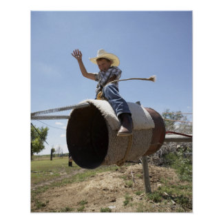 Boy (8-10) riding makeshift rodeo bull poster