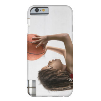Boy aiming a shot with a basketball in a school barely there iPhone 6 case