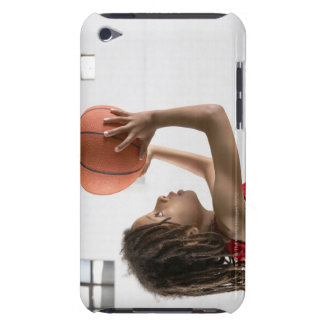 Boy aiming a shot with a basketball in a school barely there iPod case