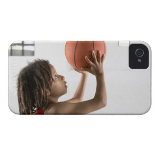 Boy aiming a shot with a basketball in a school iPhone 4 Case-Mate case