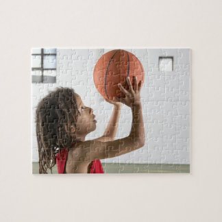 Boy aiming a shot with a basketball in a school jigsaw puzzle