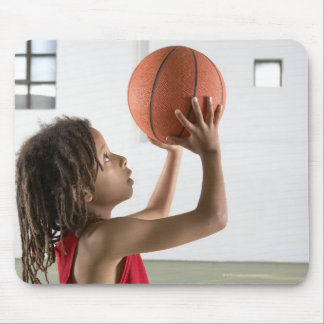 Boy aiming a shot with a basketball in a school mouse pad