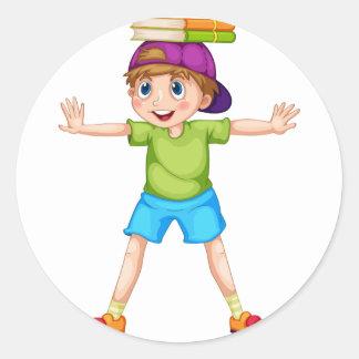 Boy and books classic round sticker