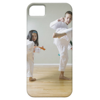 Boy and girl (4-9) practising Taekwondo kicks iPhone 5 Cases