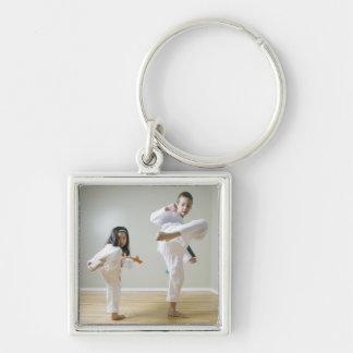 Boy and girl (4-9) practising Taekwondo kicks Silver-Colored Square Keychain