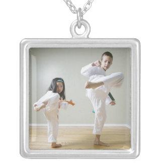 Boy and girl (4-9) practising Taekwondo kicks Square Pendant Necklace